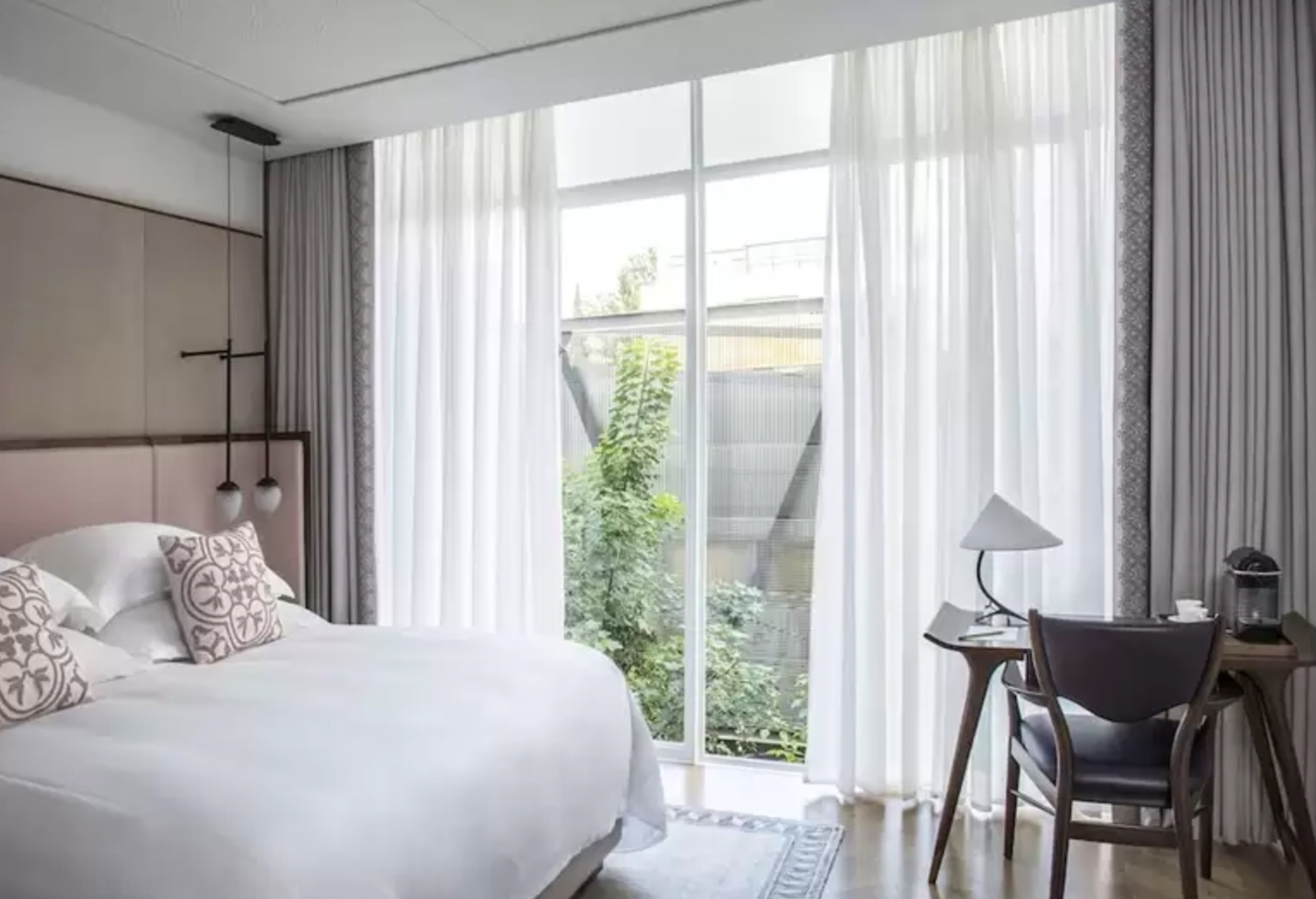 The guest rooms and suites at The Norman Tel Aviv are elegant and contemporary in design