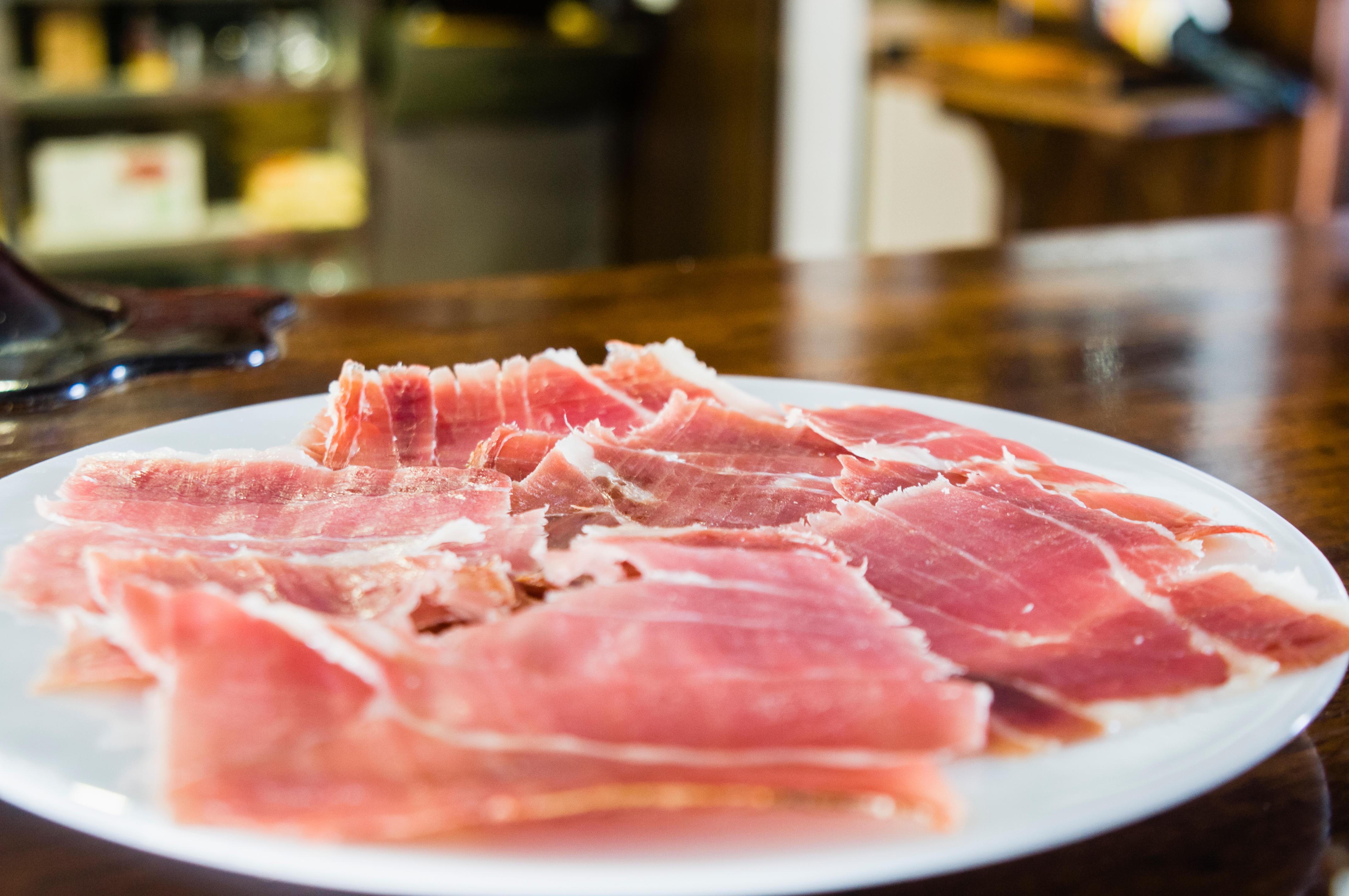 Spanish ham (Jamon iberico, Iberian ham, pata negra) cured ham served as a tapas in a bar