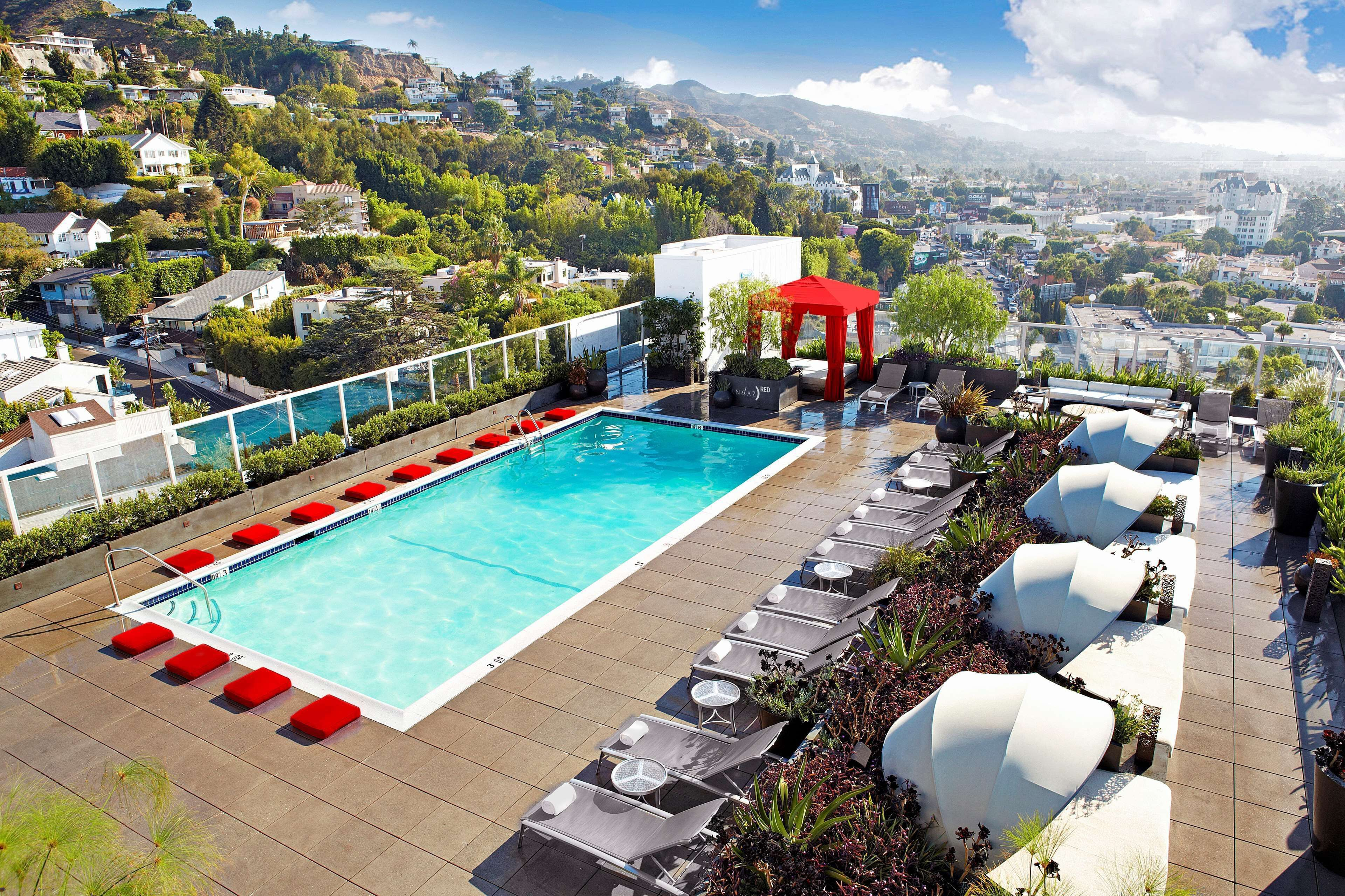 Live Los Angeles like a star at the rooftop pool at Andaz West Hollywood, with its views of the Hollywood Hills and Sunset Strip