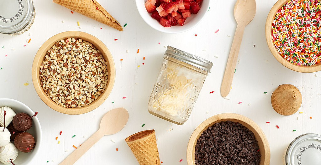 ice cream sundae toppings and spoons chocolate covered cherries sprinkles nuts chocolate chips sugar cones | © Shari's Berries/Flickr