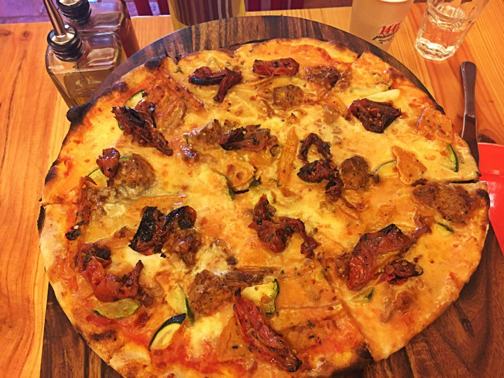 Gourmet pizza with four kinds of cheese and an assortment of exotic toppings | Courtesy of 1441 Pizzeria