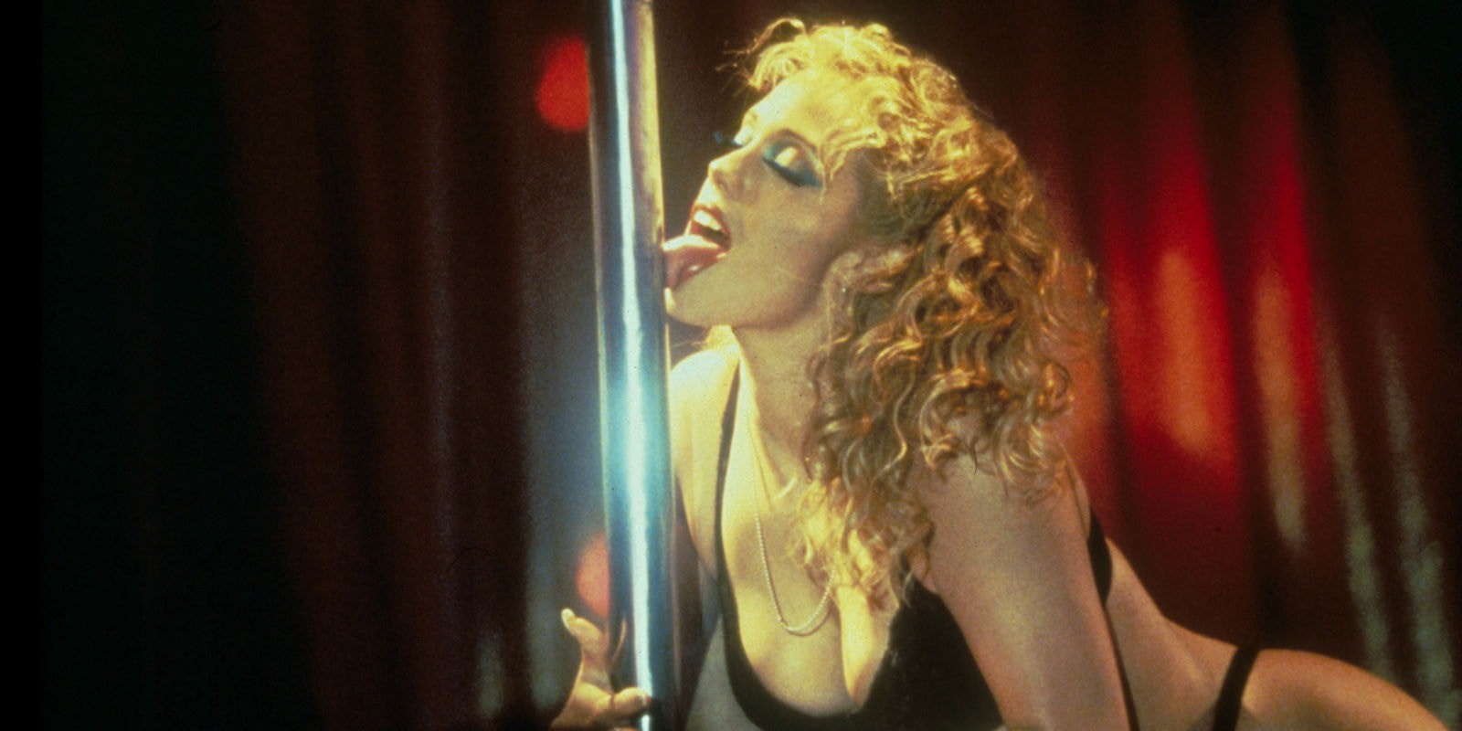 Elizabeth Berkley displays her pole dancing skills in Showgirls