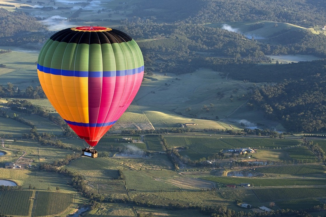 Maiden Voyage of Global Balloonings multi coloured balloon. Pilot, Brian Garth. Global Ballooning in Victoria's Yarra Valley.