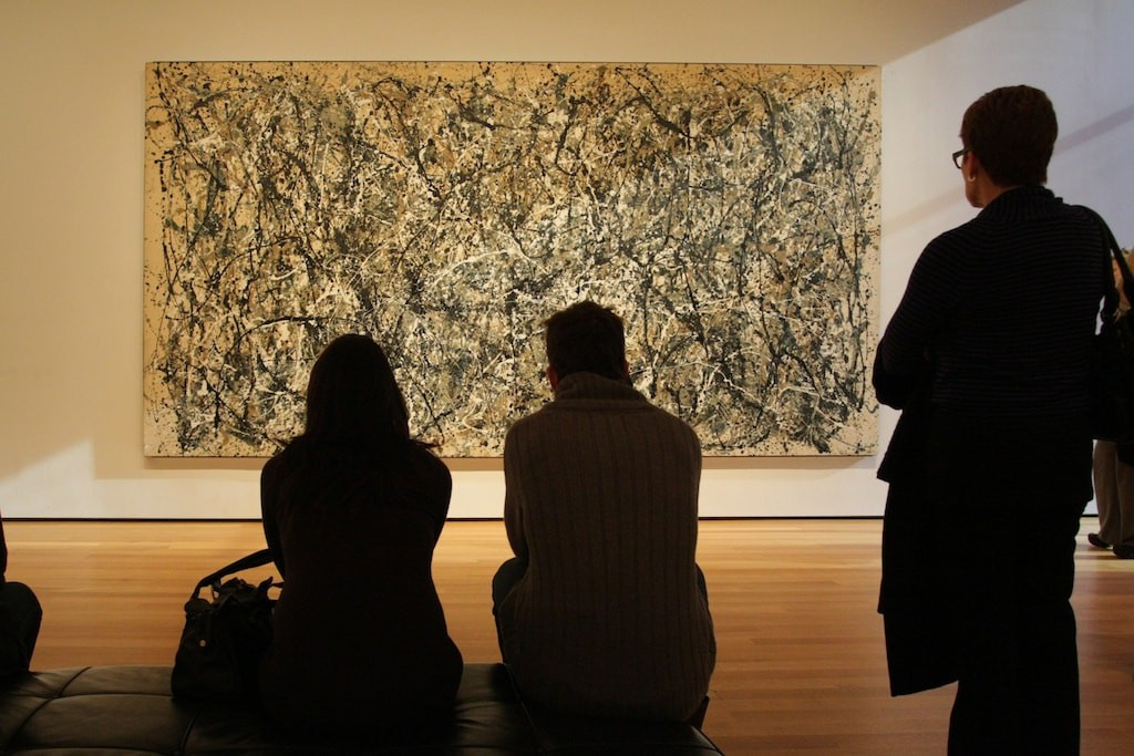 People looking at Jackson Pollock's 'One: Number 31' (1950) | © Pete/Flickr