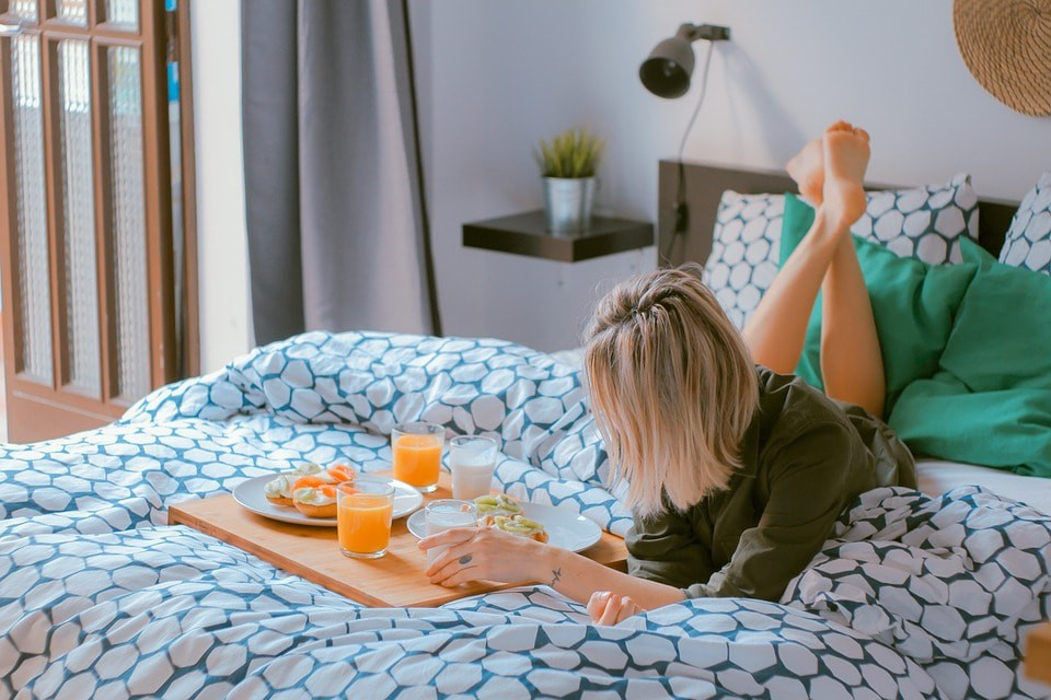 Woman Enjoying Breakfast in Bed   (c) StockSnap/Pixabay
