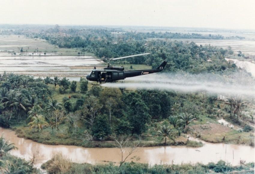 U.S. Huey helicopter spraying Agent Orange in Vietnam