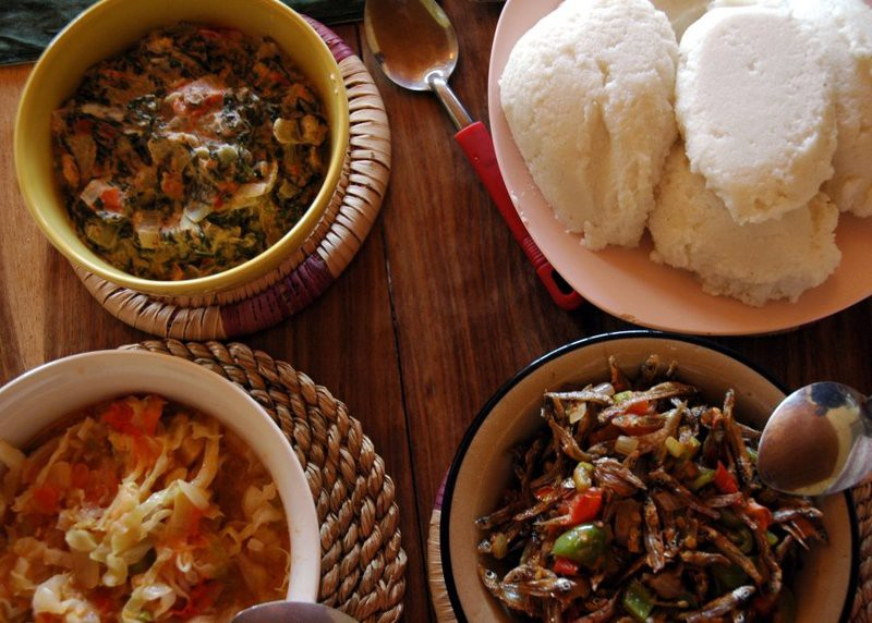 Nisima and three relishes is a popular and common dish in Zambia