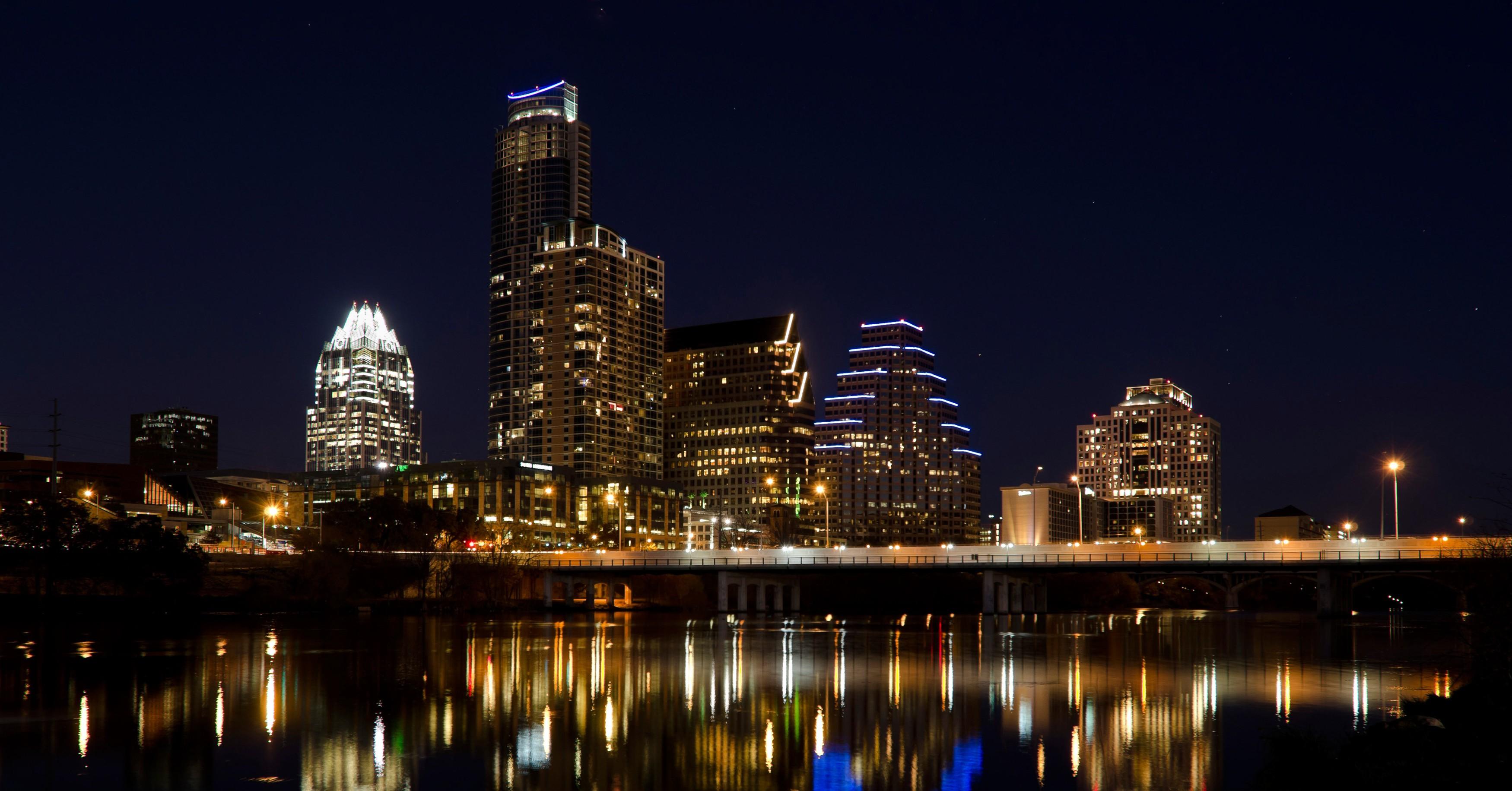 Skyline at night from across Lady Bird Lake, Austin, Texas, USA.