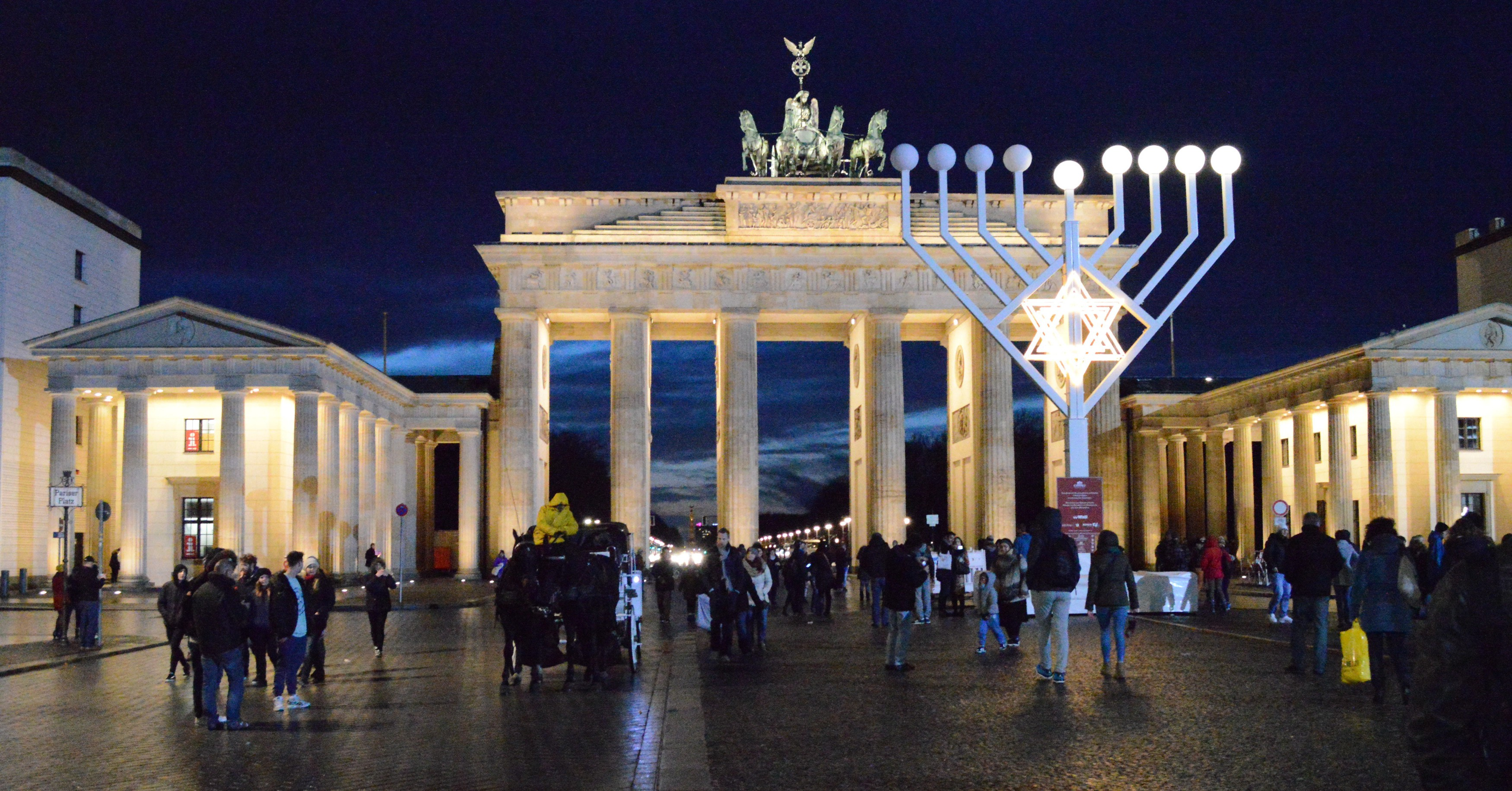 A Hanukkah menorah stands in front of Brandenburg Gate